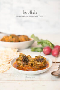 Koofteh Berenji are Persian meatballs that are tender and mixed with an assortment of fresh herbs and rice, stuffed with raisins, and simmered in a simple tomato broth. -- FamilySpice.com