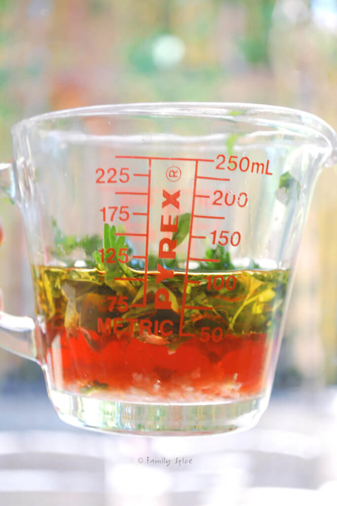 Italian marinade for steak in a glass measuring cup