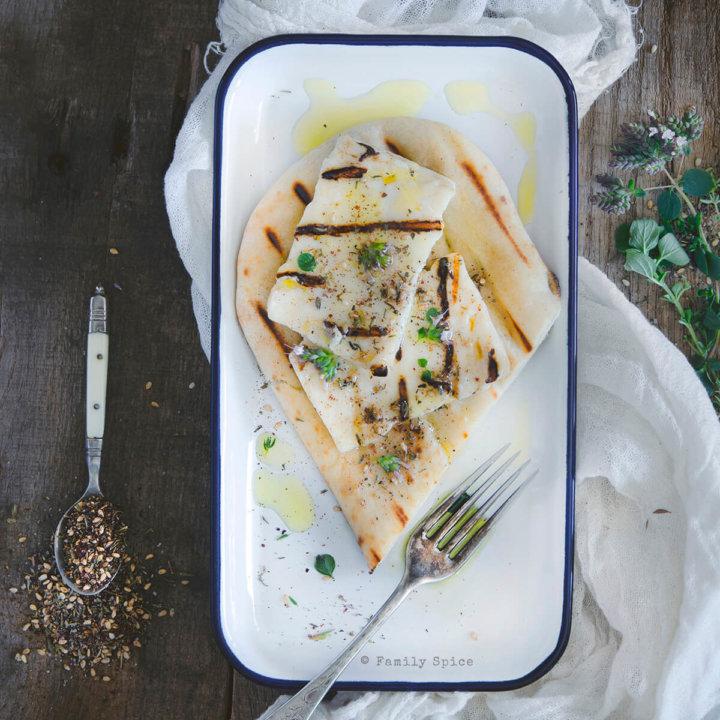 Grilled Halloumi with Za'atar Olive Oil over pita bread by FamilySpice.com