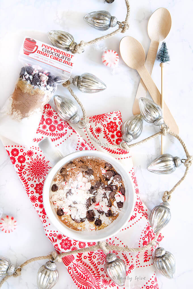 Peppermint chocolate mug cake mix in a white mug and ready to bake in the microwave by FamilySpice.com