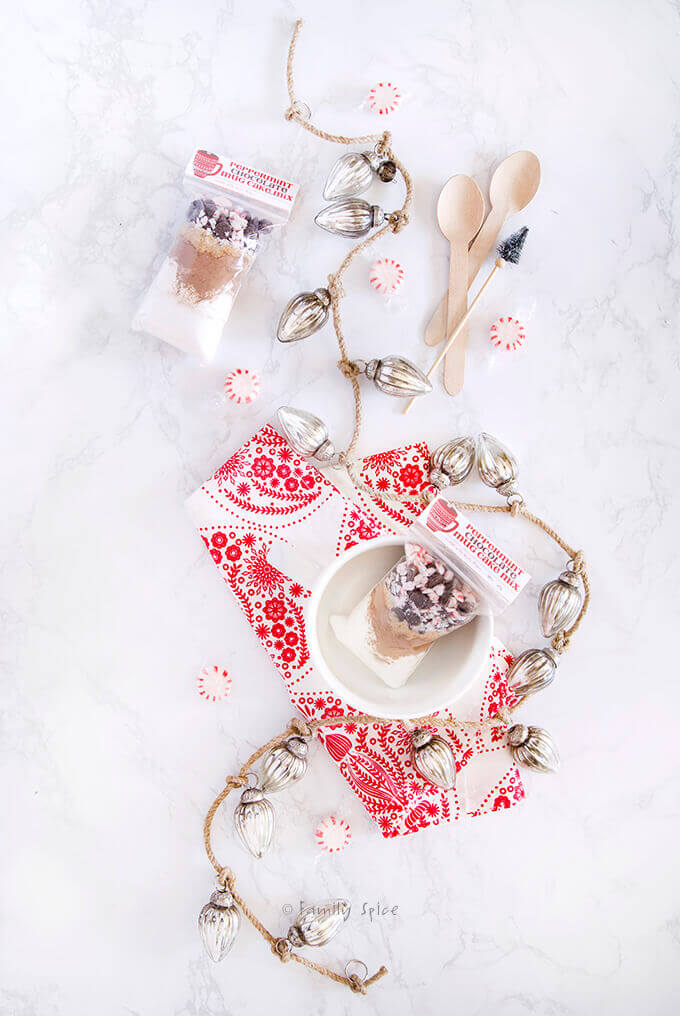 Top view of peppermint chocolate mug cake mix packed in gift bags with free printable by FamilySpice.com