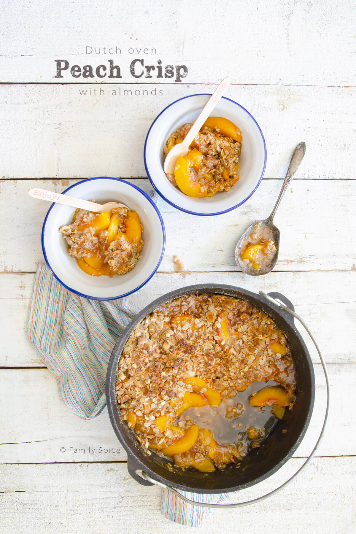 Overhead shot of Dutch oven peach crisp with almonds by FamilySpice.com