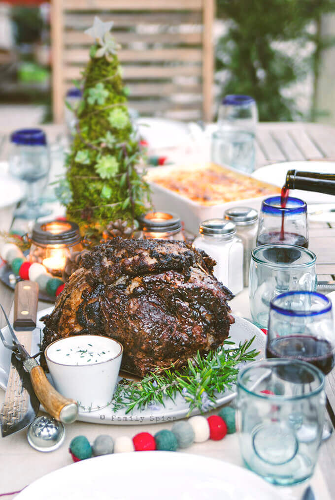 Table set for Christmas dinner featuring Smoked Prime Rib Roast with Herb Garlic Crust and Horseradish Cream by FamilySpice.com