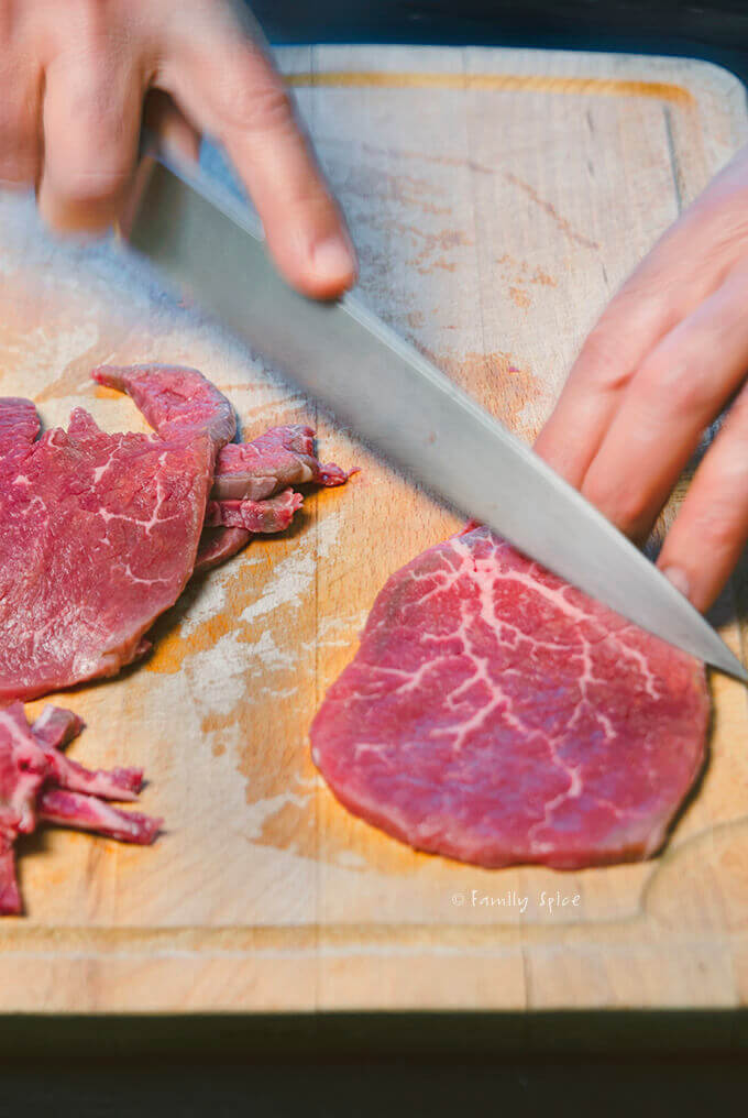 Removing fat from slices of meat for oven beef jerky by FamilySpice.com