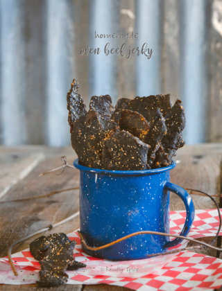A blue cup filled with the best homemade oven beef jerky by FamilySpice.com