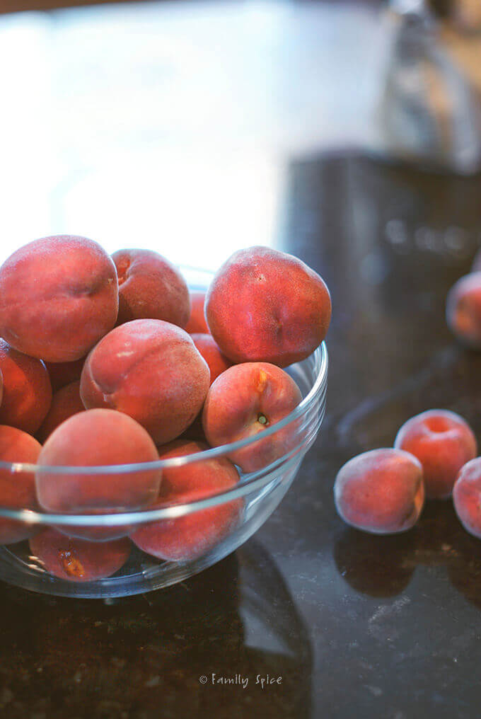 A bowl of fresh peaches by FamilySpice.com