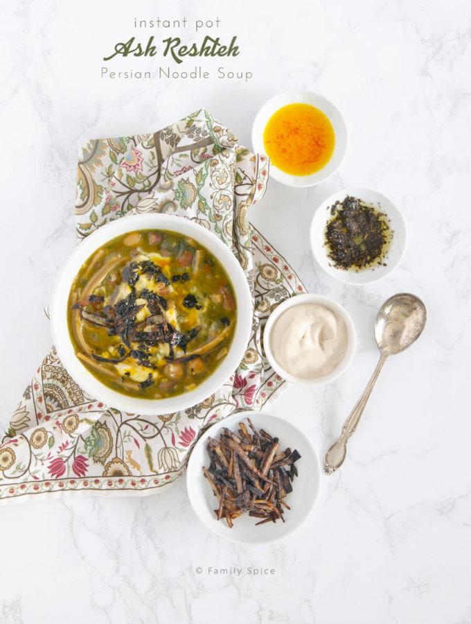 Overhead shot of a bowl of instant pot ash reshteh (Persian noodle soup) by FamilySpice.com
