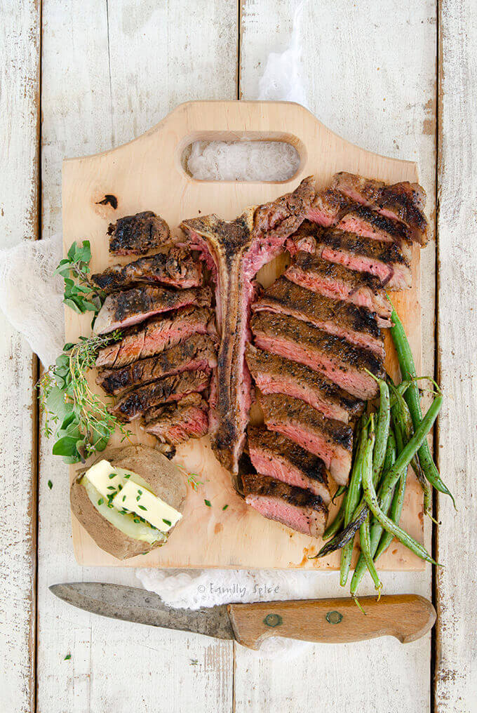 Overhead Shot of a Grilled Porterhouse Steak Cut into Slices with Cowboy Steak Rub by FamilySpice.com