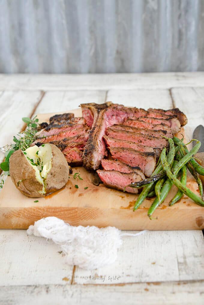 Closeup of a Grilled Porterhouse Steak Cut into Slices with Cowboy Steak Rub by FamilySpice.com