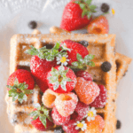 pinterest image for Whole Wheat Chocolate Chip Waffles Topped with Berries by FamilySpice.com