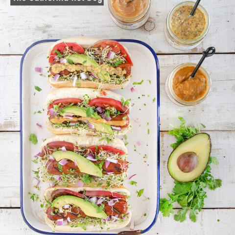 Gourmet hot dog toppings like avocado, tomato, sprouts, cilantro and red onions for the California Hot Dog