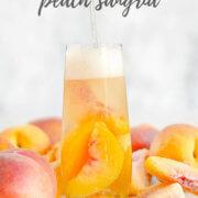 Pouring sparkling peach sangria into a glass by FamilySpice.com