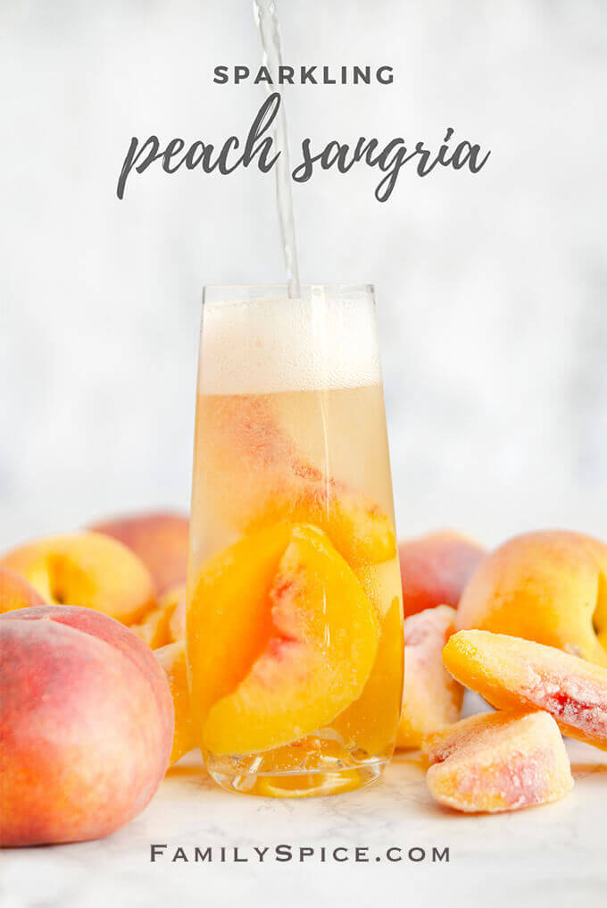 Pouring sparkling peach sangria into a glass by FamilySpice.com