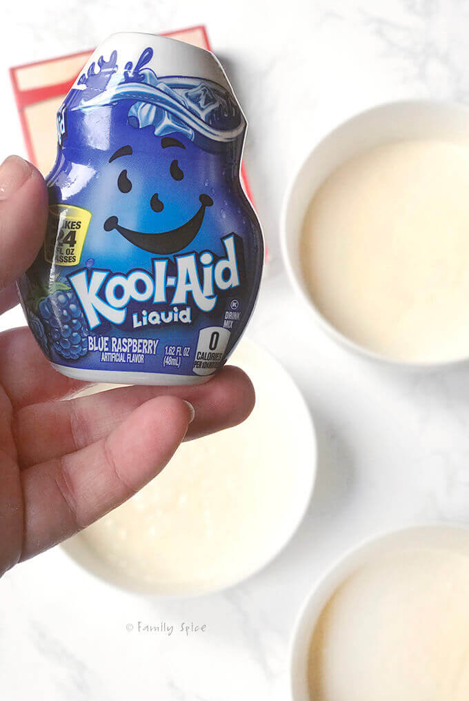 Adding liquid kool aid to make batter for ombre cake by FamilySpice.com