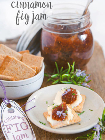 A small plate with crackers smeared with cheese and topped with cinnamon fig jam by FamilySpice.com