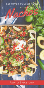 Fully loaded sheet pan leftover pulled pork nachos topped with sour cream and guacamole by FamilySpice.com