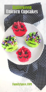 Top view of a plate of halloween unicorn cupcakes featuring red devil unicorn cupcakes and zombie unicorn cupcakes by FamilySpice.com