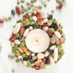 Overhead shot of a votive candle holder made with dry beans and glue by FamilySpice.com