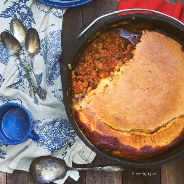 Dutch Oven Chili with Cornbread Baked on Top by FamilySpice.com
