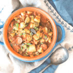 pinterest image for a large bowl of chunky chicken and sausage potato gumbo by FamilySpice.com