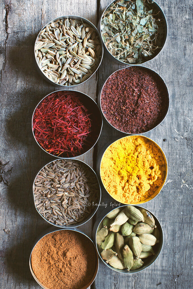 A variety of brightly colored spices used in Persian recipes by FamilySpice.com