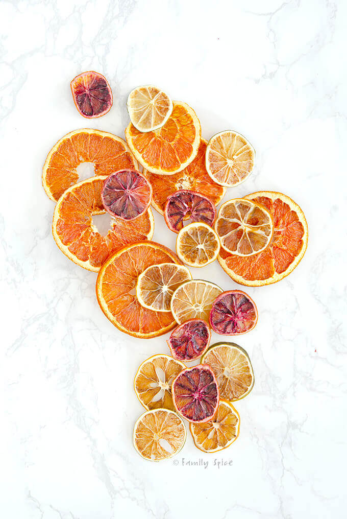 Overhead shot of dried oranges, dried lemons, dried limes and dried blood oranges by FamilySpice.com