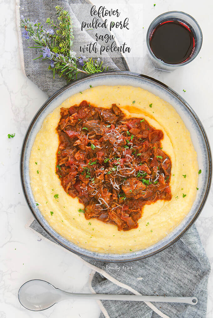 Overhead shot of a shallow bowl of polenta topped with pulled pork ragu by FamilySpice.com