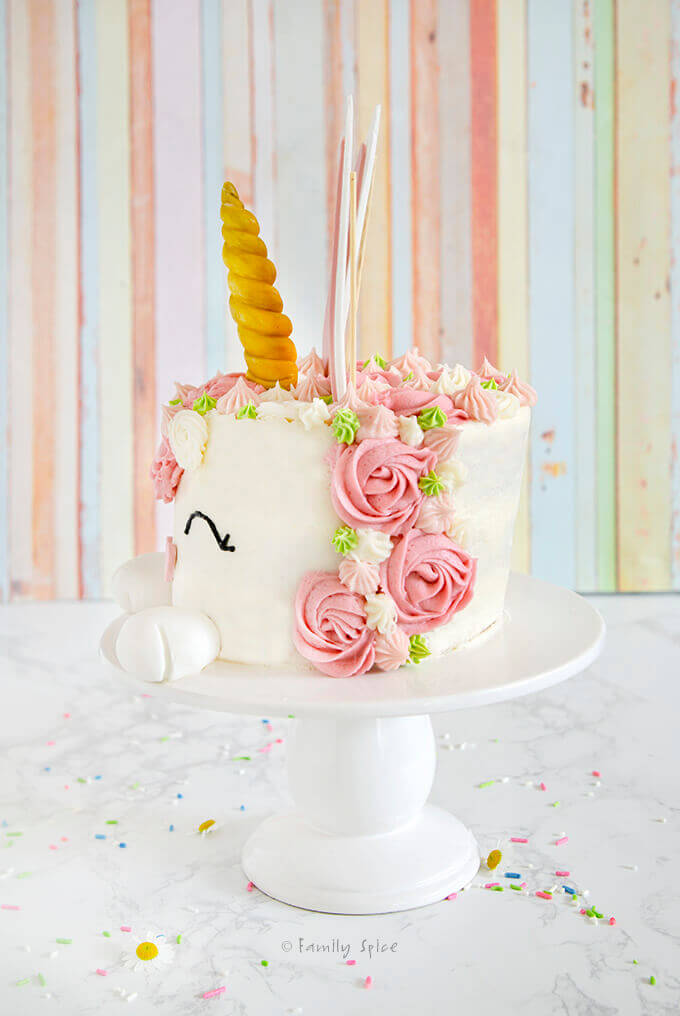 Side view of an Easter bunny unicorn cake with pink rosette unicorn mane down the side by FamilySpice.com