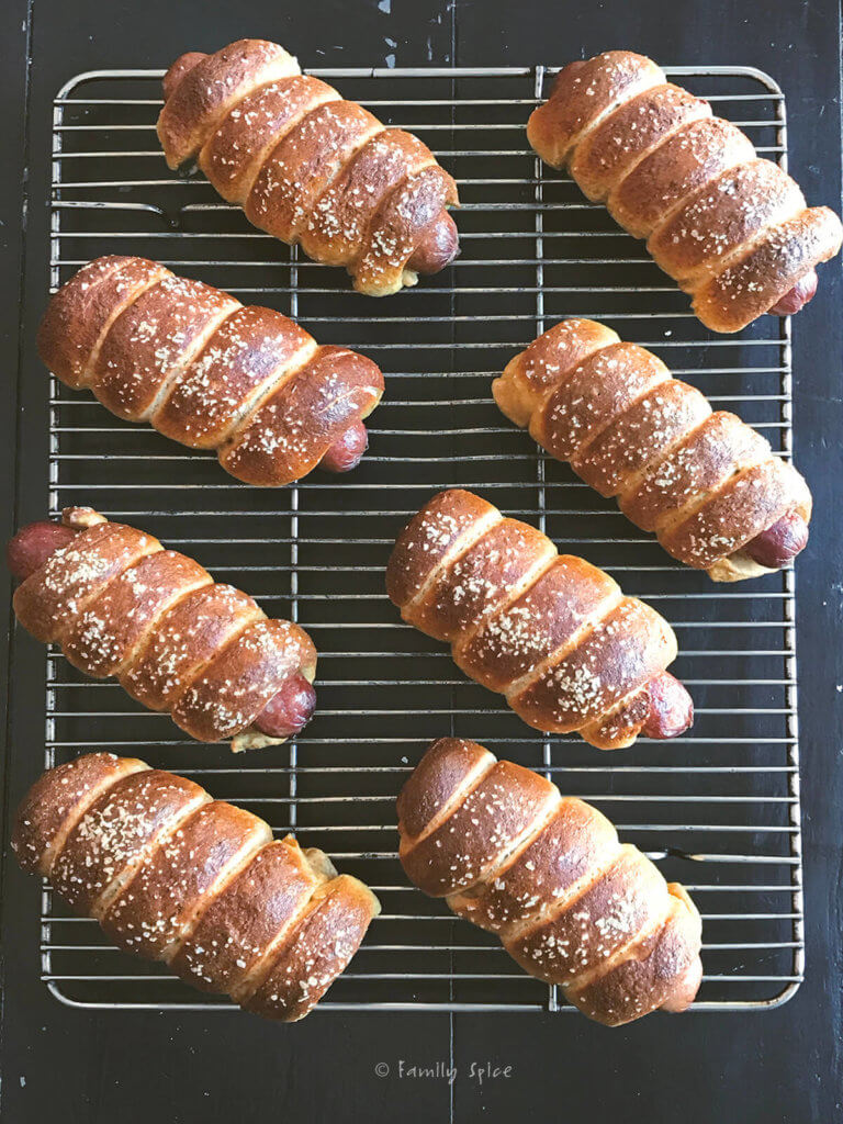 Whole wheat pretzel dogs cooling on a cooling rack