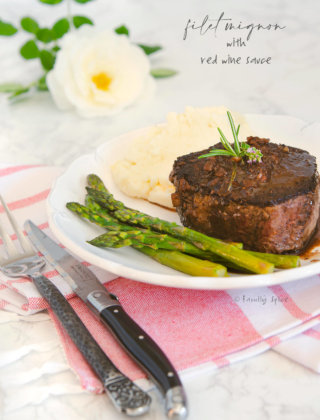 A plate with filet mignon, asparagus and mashed potatoes by FamilySpice.com