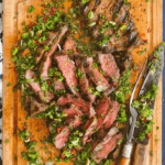 Pinterest image for flat iron steaks with cutting board sauce by FamilySpice.com