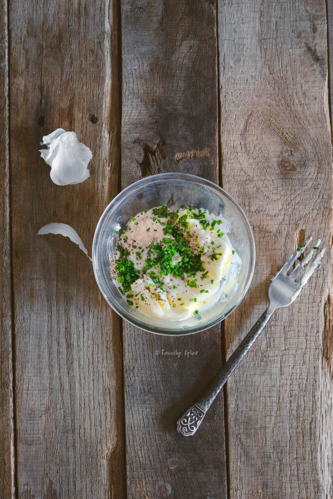 ingredients to make horseradish compound butter in a small bowl with a fork