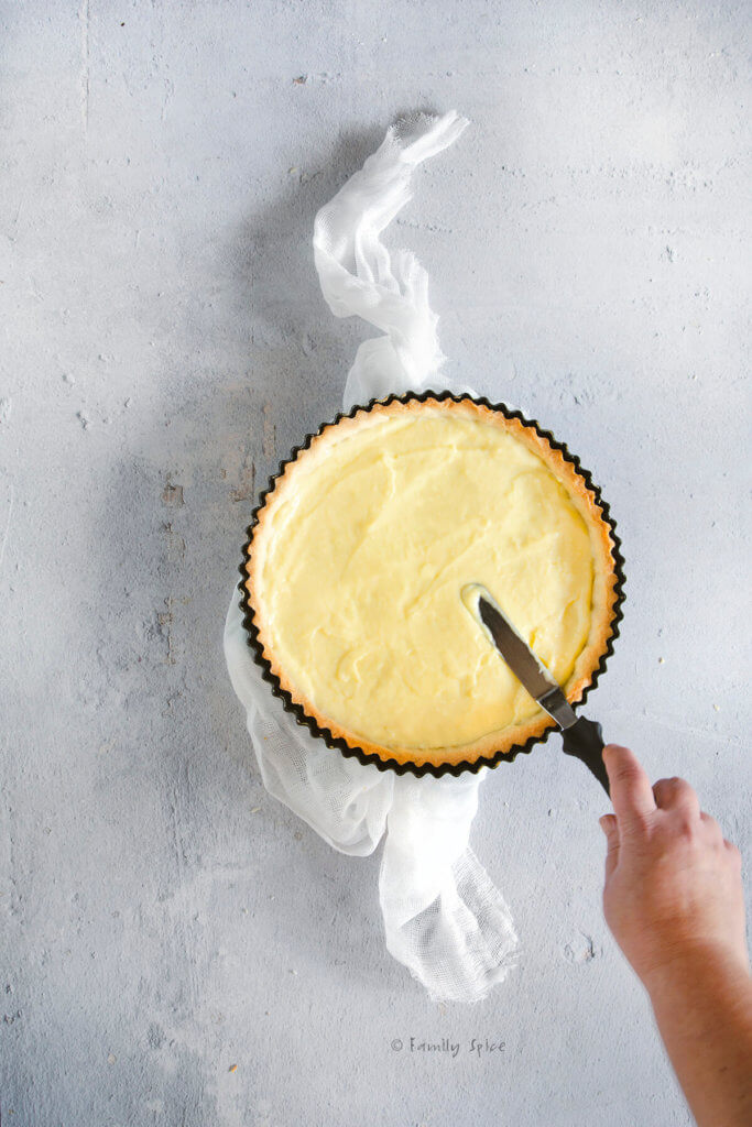Spreading pastry cream over a baked tart shell
