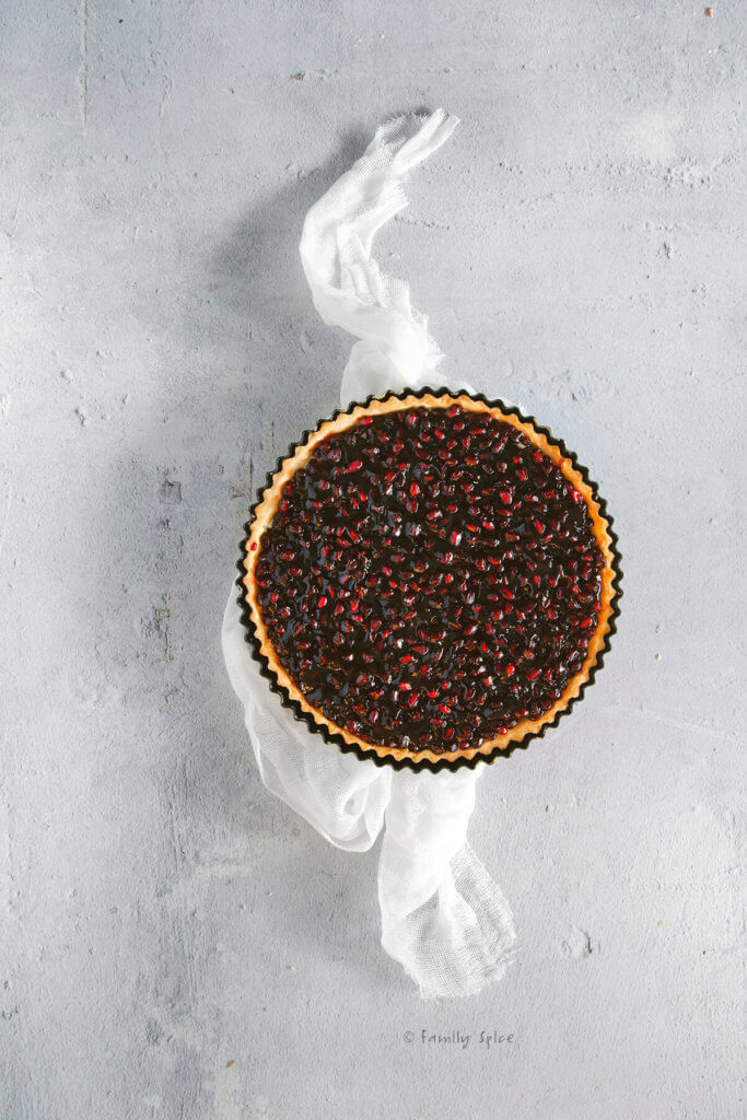 Overhead view of a pomegranate fruit tart
