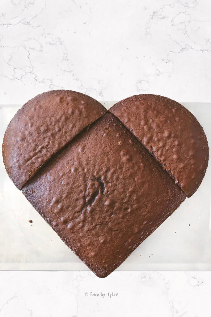 Assembled chocolate heart cake made with one round cake and one square cake
