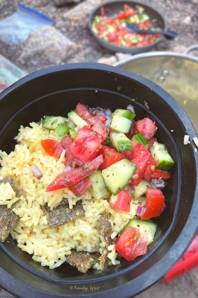 Persian ground beef kebab and saffron rice with shirazi salad in a bowl outisde